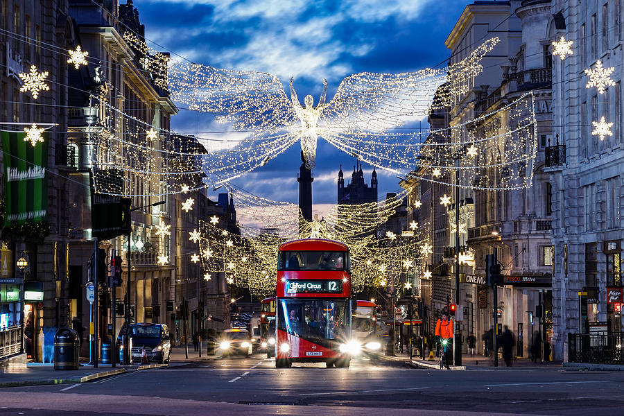 An Iconic Double Decker Red Bus In London, England, At Piccadilly Circus During Christmas. Photograph