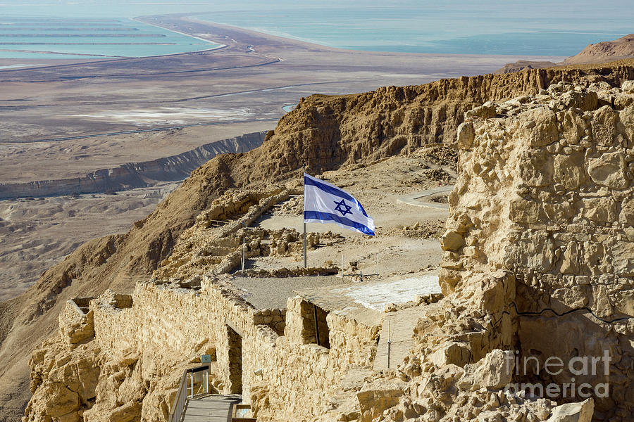 An Israeli flag flies near the entrance to the top of Masada in  by William Kuta