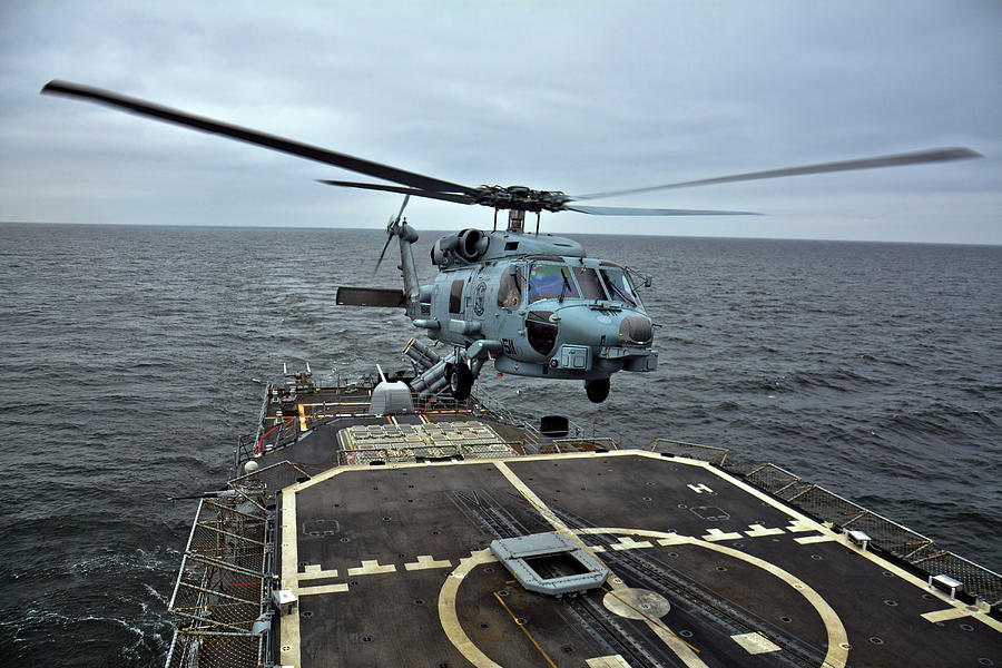 An Mh-60r Seahawk Helicopter Launches by Stocktrek Images