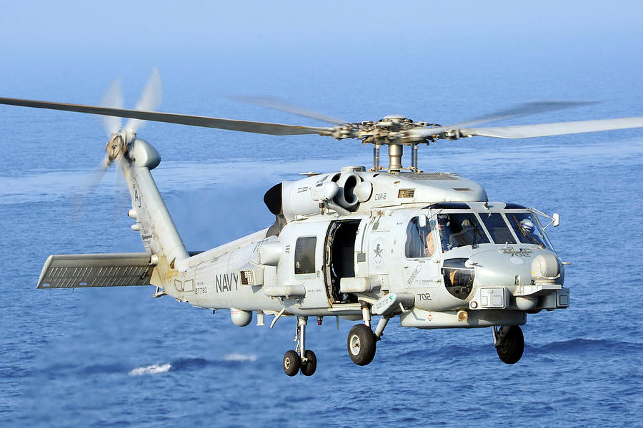 Navy Photograph - An Mh-60r Seahawk Helicopter Takes by Stocktrek Images