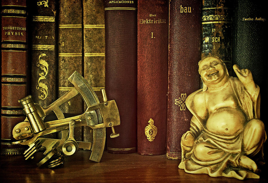 Ancient books, Buddha and sextant by Luisa Vallon Fumi