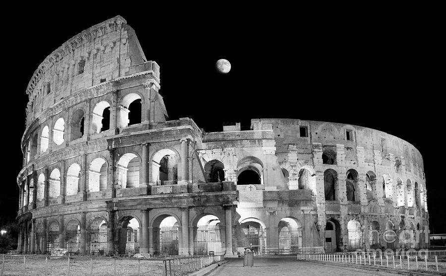 Night Photograph - Ancient Rome in Black and White - Roman Colosseum at night by Stefano Senise
