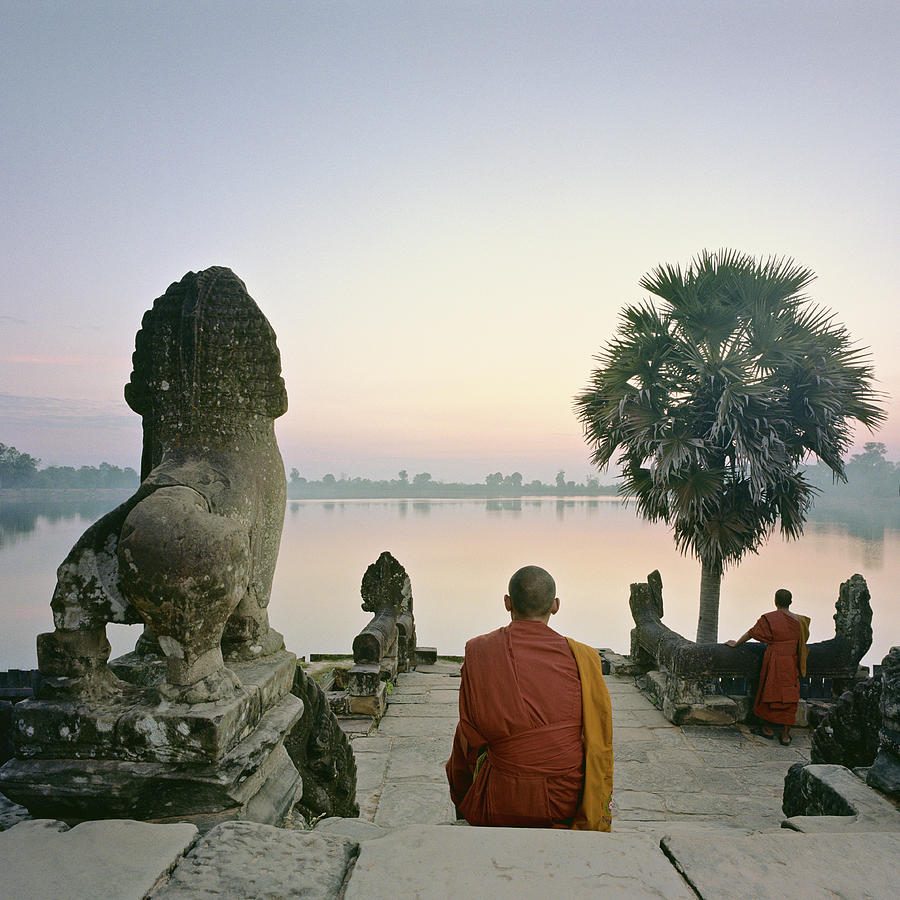 Angkor Wat, Buddhist Monks At Waters Photograph by Martin Puddy