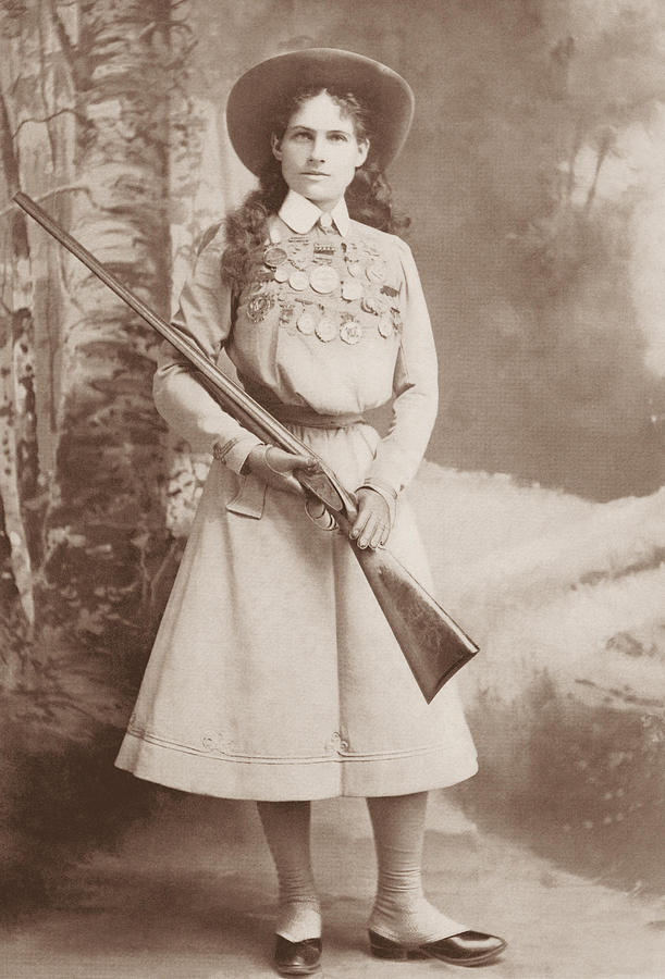 Annie Oakley Photograph - Annie Oakley Holding A Rifle - 1899 by War Is Hell Store