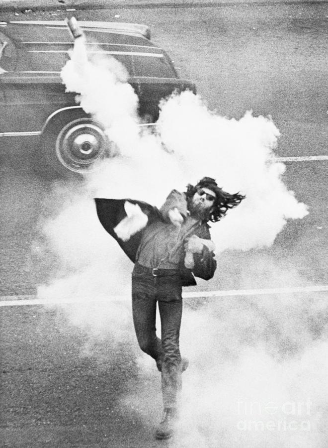 Anti-war Demonstrator Throwing Tear Gas Photograph by Bettmann