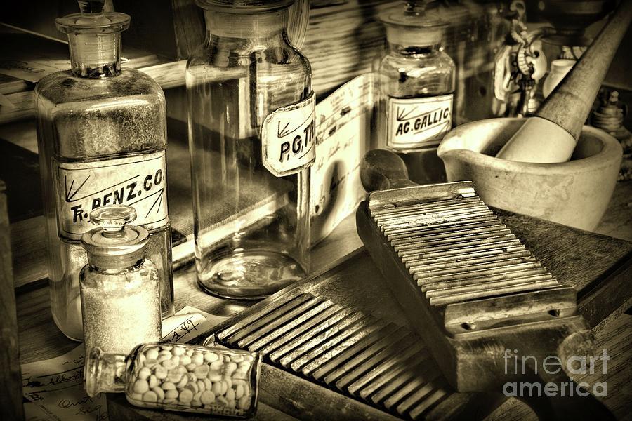 Paul Ward Photograph - Apothecary-vintage Pill Maker Sepia by Paul Ward