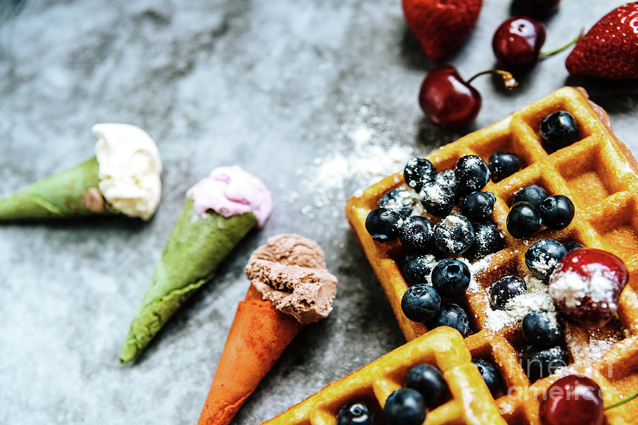 Appetizing ice cream with fruits and waffles, the ideal snack in a restaurant in summer. by Joaquin Corbalan