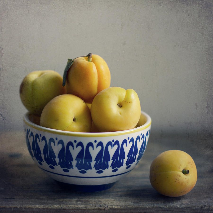 Apricots In Bowl On Wooden Table Photograph by Copyright Anna Nemoy(xaomena)