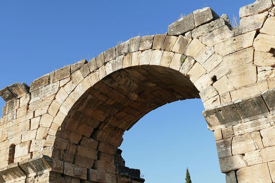 Arch of  the ruins of the Roman Basilica Baths by Steve Estvanik