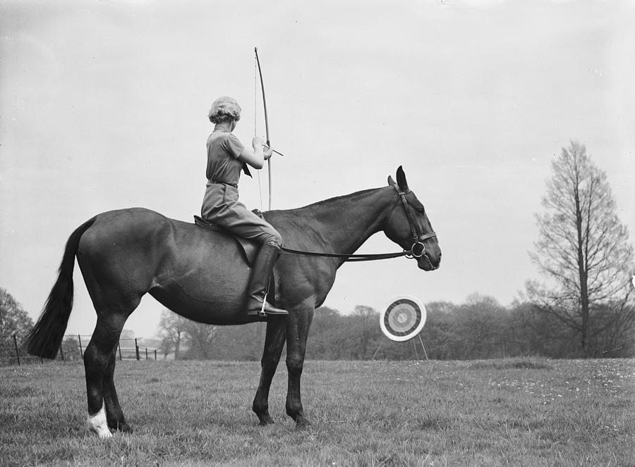 Archery On Horseback Photograph by Ward