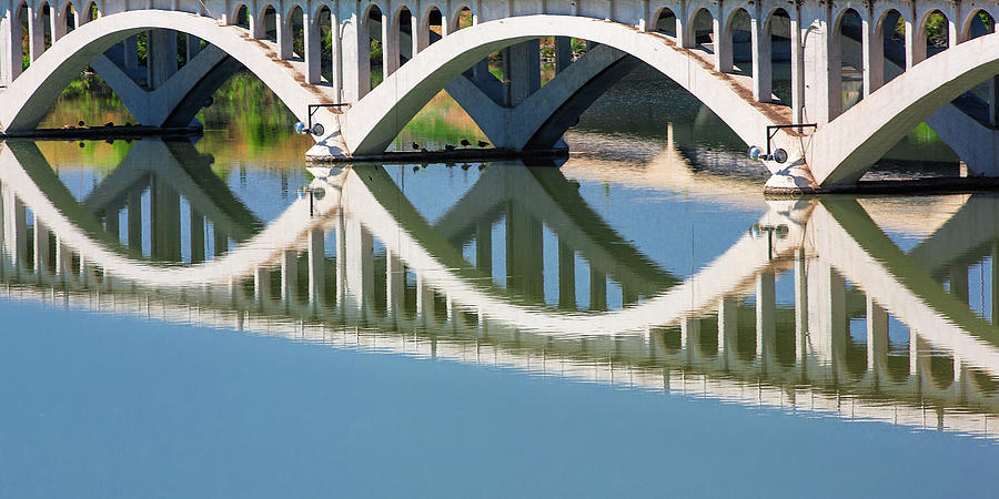 Abandoned Photograph - Arches Reflected by Todd Klassy