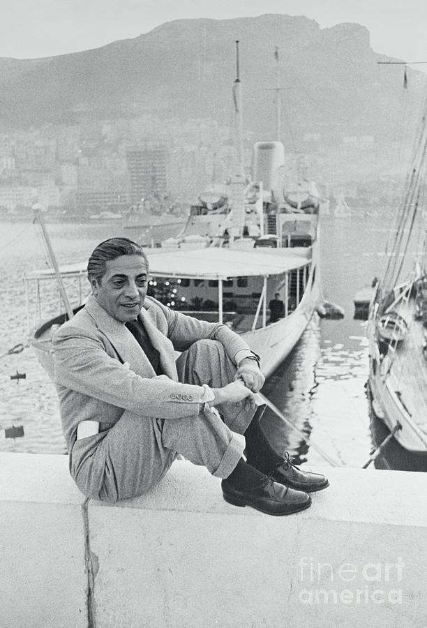Aristotle Onassis Sitting On Side Photograph by Bettmann