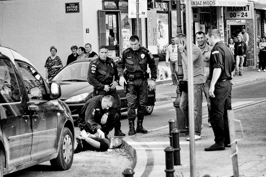 Police Photograph - Arresting by Dejan Miloradov