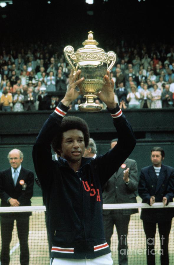 Arthur Ashe Holding Up Wimbledon Trophy Photograph by Bettmann