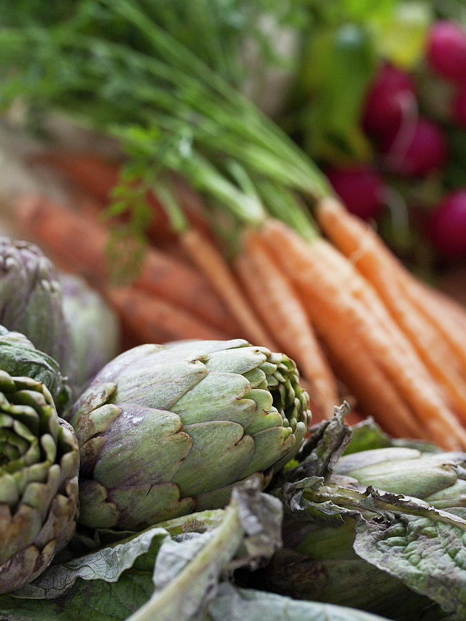 Artichokes And Carrots Photograph by Johner Images