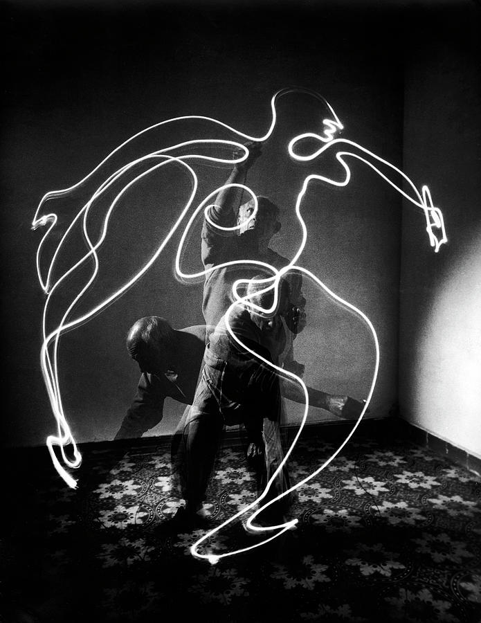 Artist Pablo Picasso Painting With Photograph by Gjon Mili