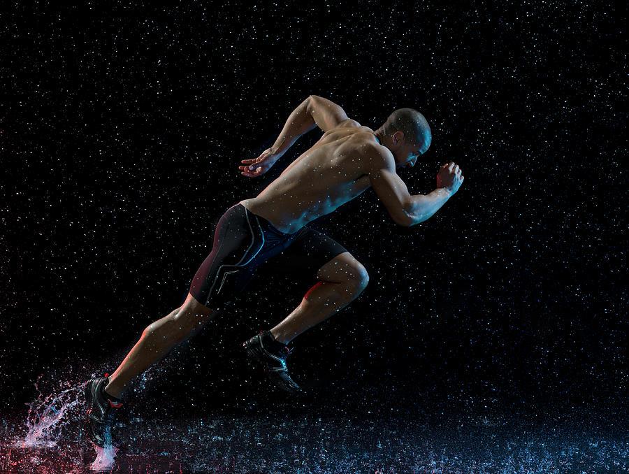 Athlete Runner Running Through Rain Photograph by Jonathan Knowles