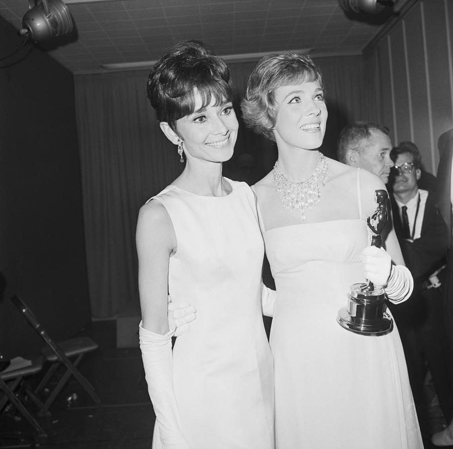 Audrey Hepburn And Julie Andrews With Photograph by Bettmann