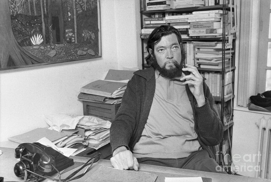 Author Julio Cortazar Sitting At Desk Photograph by Bettmann