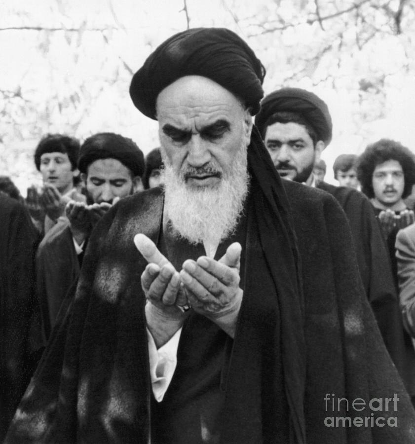 Ayotollah Ruhollah Khomeini Praying Photograph by Bettmann