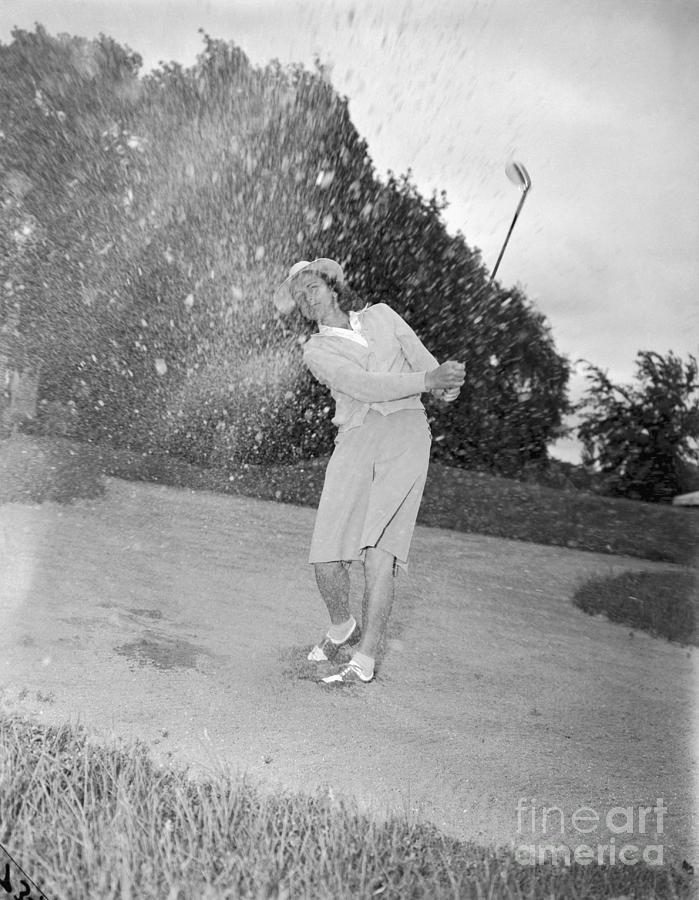 Babe Didrikson Spraying Sand With Golf Photograph by Bettmann