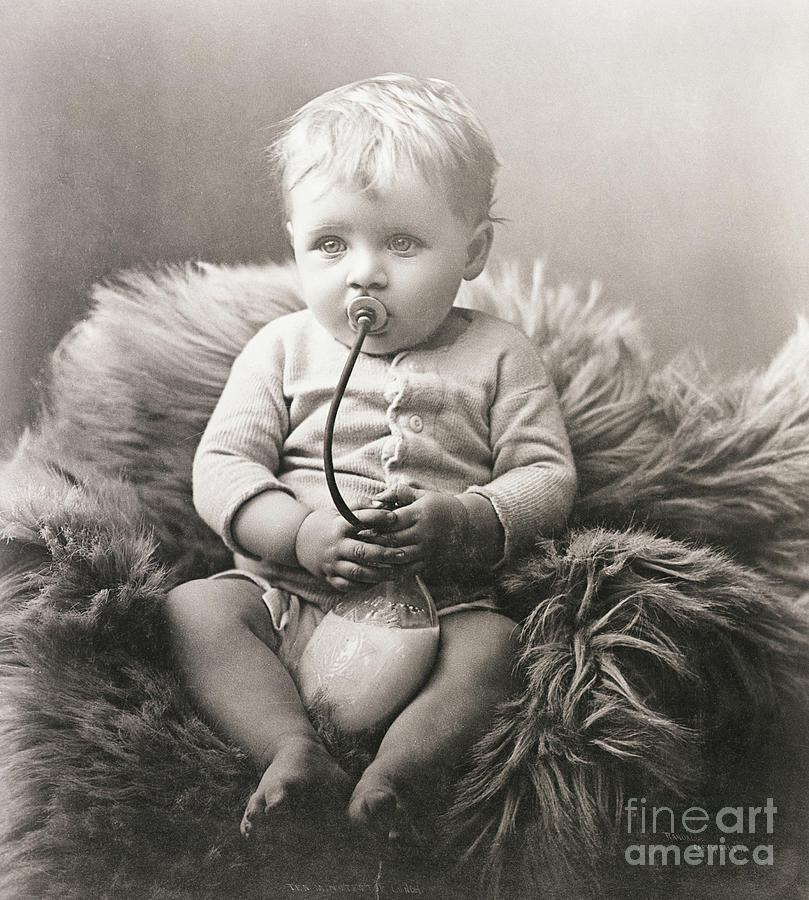 Baby Boy On Bear Rug Sucking On Milk Photograph by Bettmann