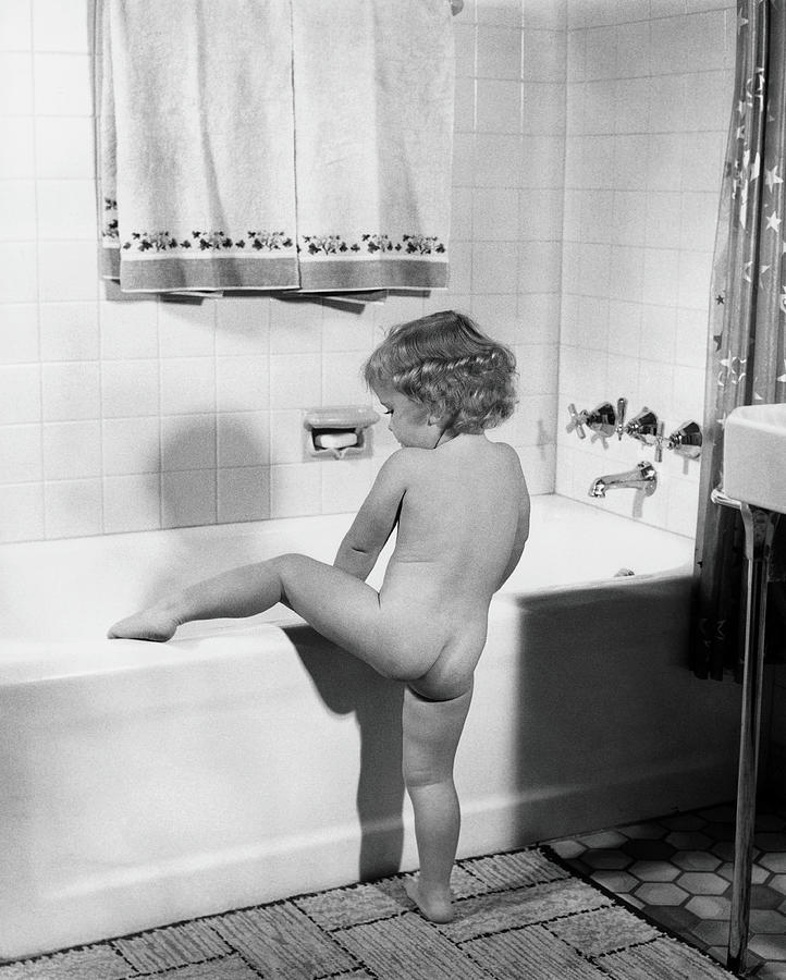Baby Girl Climbing Into Bath Tub Photograph by H. Armstrong Roberts