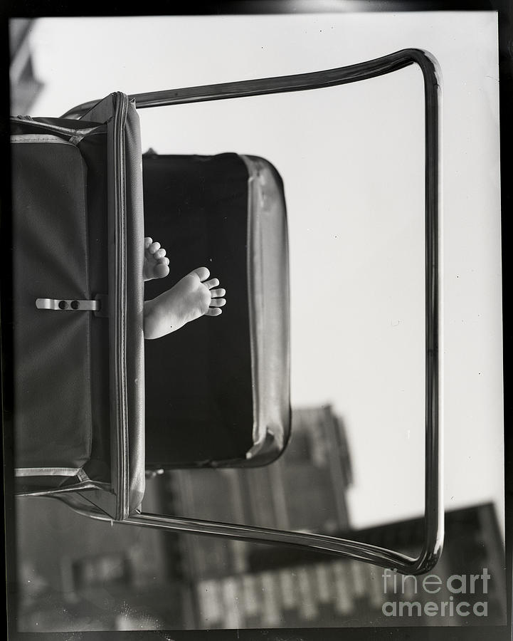 Babys Feet Peeking Out Of Carriage Photograph by Bettmann