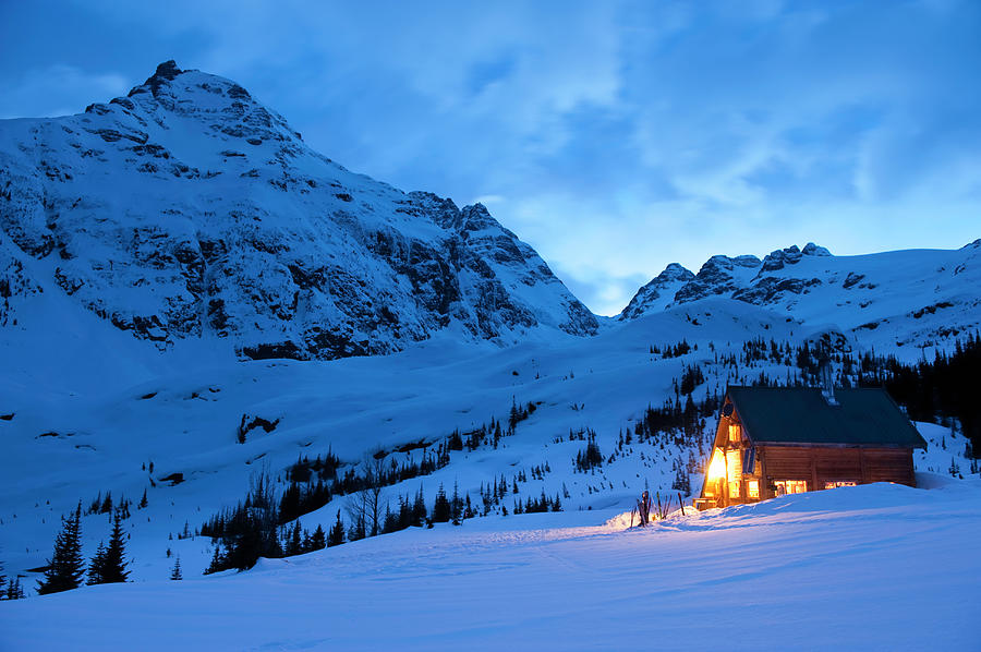 Backcountry Ski Lodge Illuminated At Photograph by Darryl Leniuk