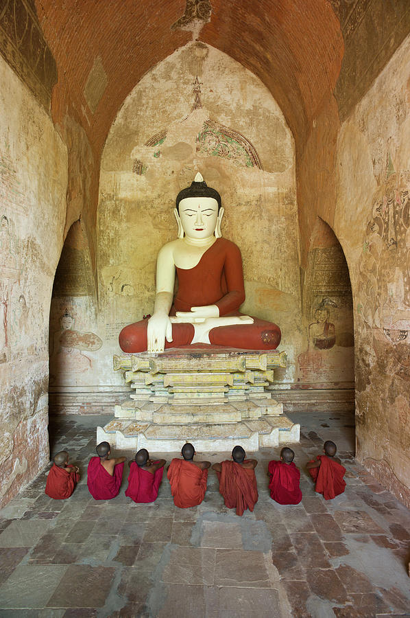 Bagan, Buddhist Monks Sitting In Temple Photograph by Martin Puddy