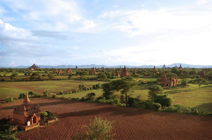 Bagan Temples And Plowed Fields W Blue Photograph by Volanthevist