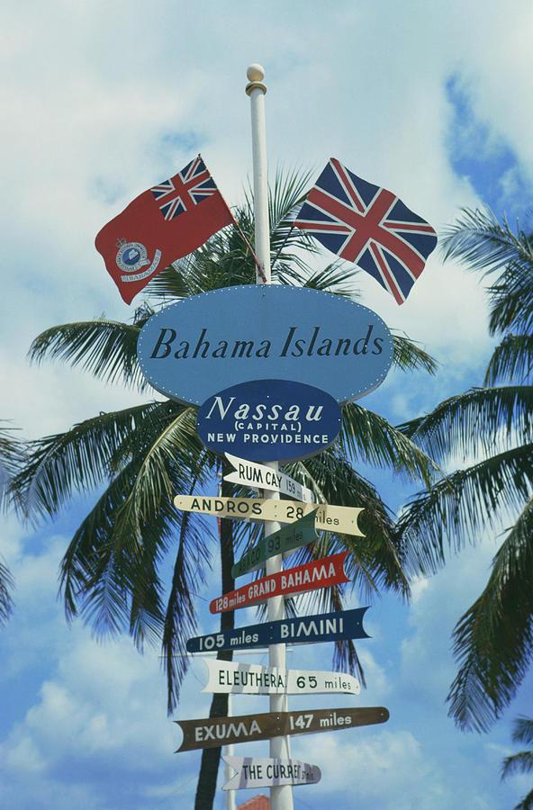 Bahamas Signpost Photograph by Slim Aarons