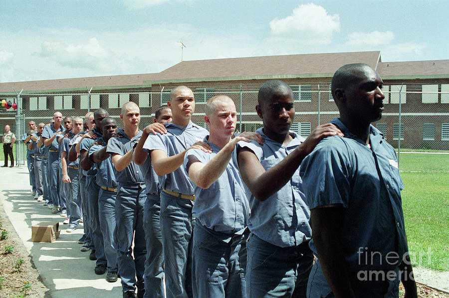 Bald Prison Inmates Marching In Yard Photograph by Bettmann