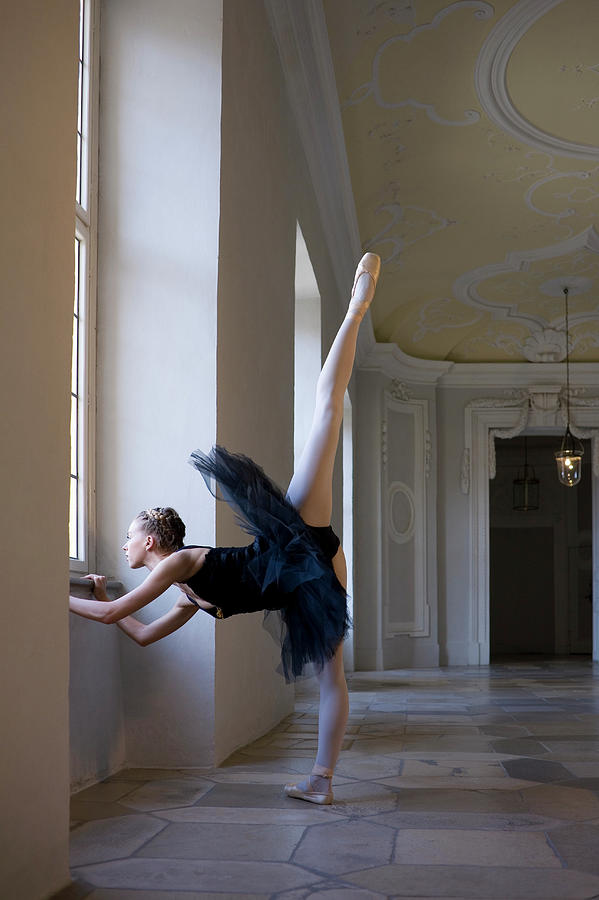 Ballerina Doing Exercise By Window Photograph by Kathrin Ziegler