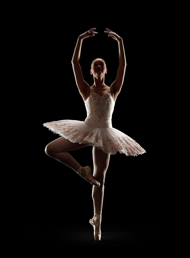 Ballerina In Releve Pose Photograph by Lewis Mulatero