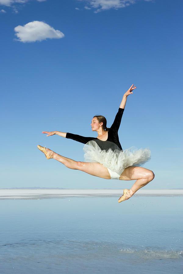 Ballerina Jumping-perfect Form Photograph by Avid creative