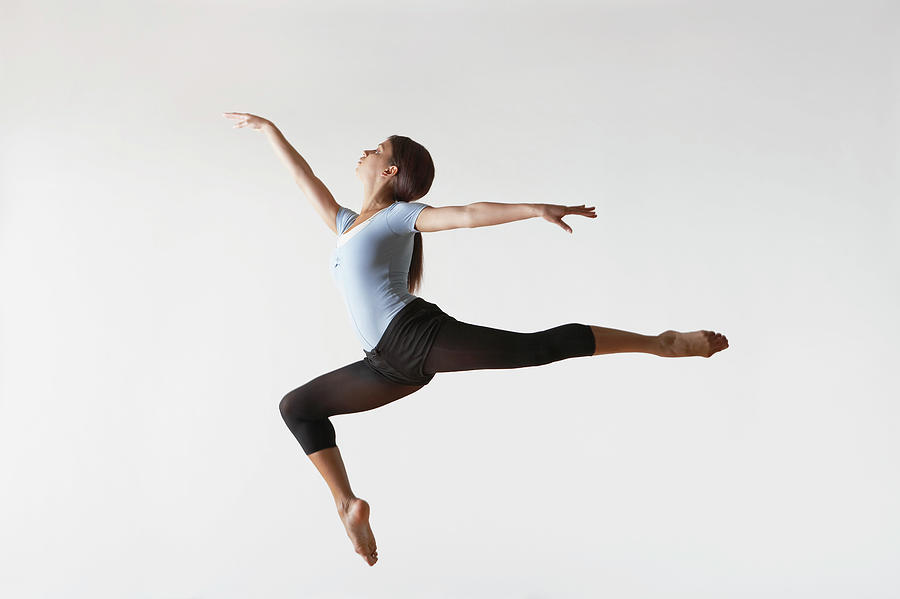 Ballerina Leaping In Mid-air Photograph by Moodboard
