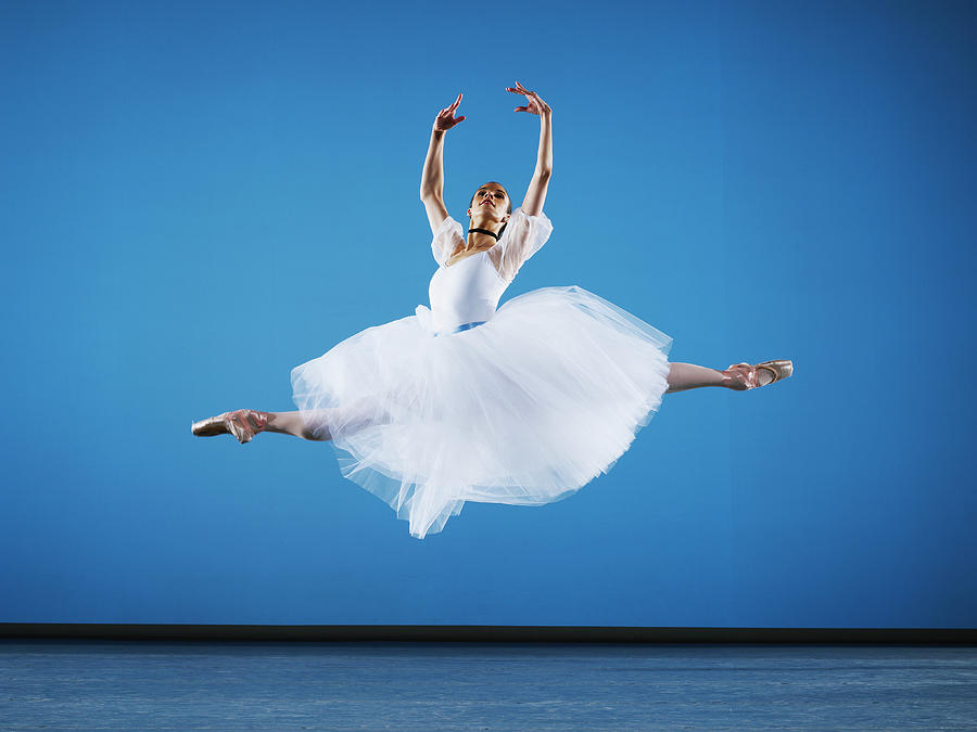 Ballerina Leaping On Stage, Arms Raised Photograph by Thomas Barwick