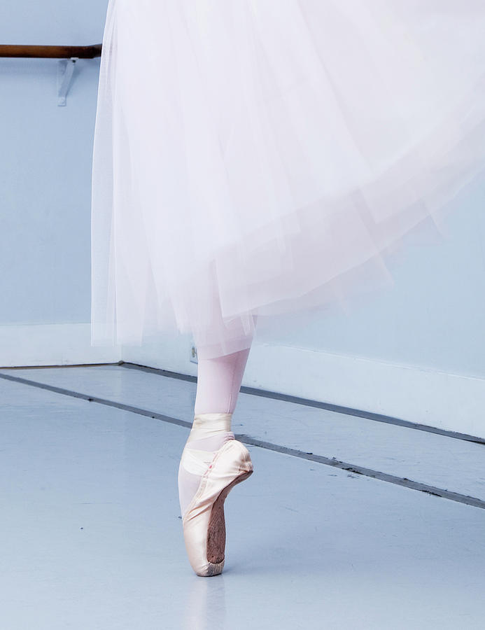 Ballerina On Pointe Low Angle View Photograph by Jonya