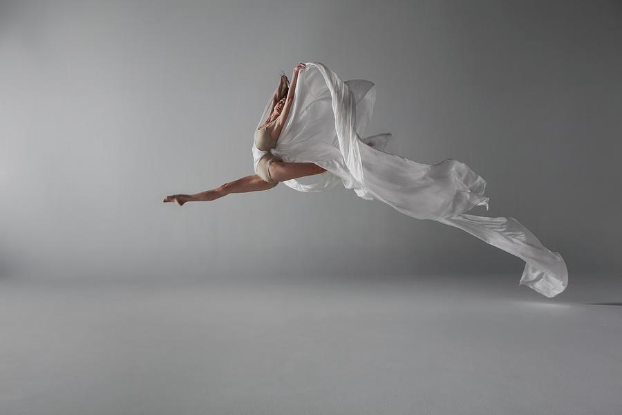 Ballerina Performing A Grand Jeté Photograph by Nisian Hughes