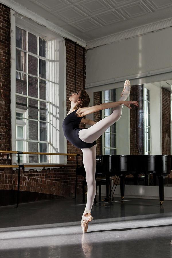 Ballerina Performing Attitude In Dance Photograph by Nisian Hughes
