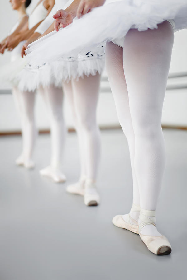 Ballet Dancers Standing In Studio Photograph by Hybrid Images