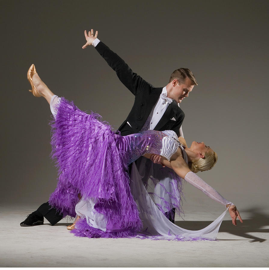 Ballroom Dancing Pair Performing Dip Photograph by Pm Images