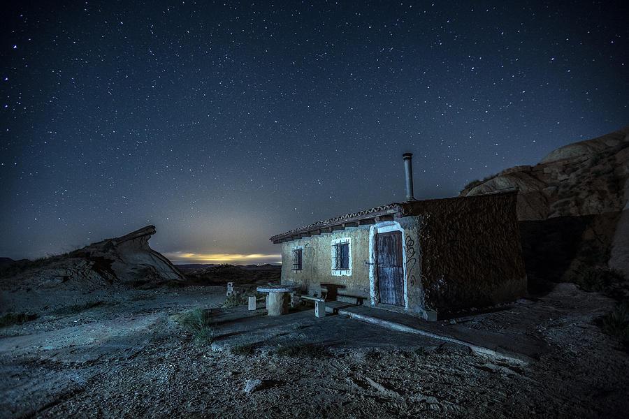 Night Photograph - Bardenas Reales - Nightscape I - Tripas Cabin by Jose Javier Duro Jimenez