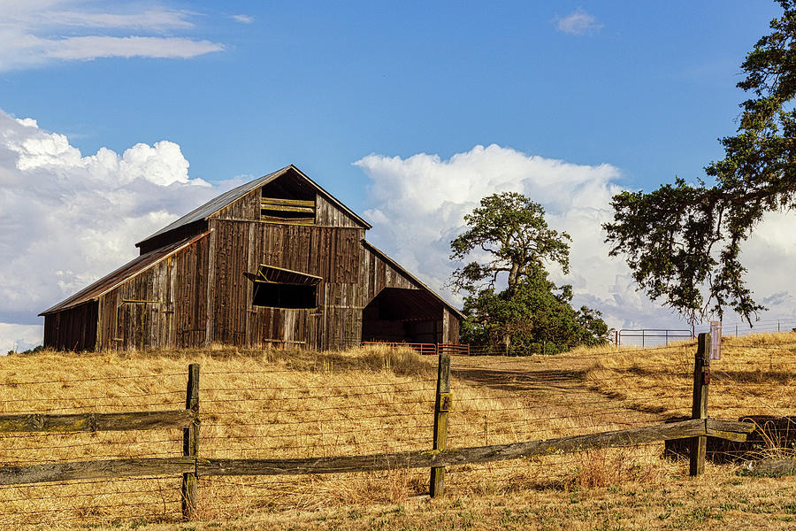 Barn with Fence in Foreground by Randy Bayne