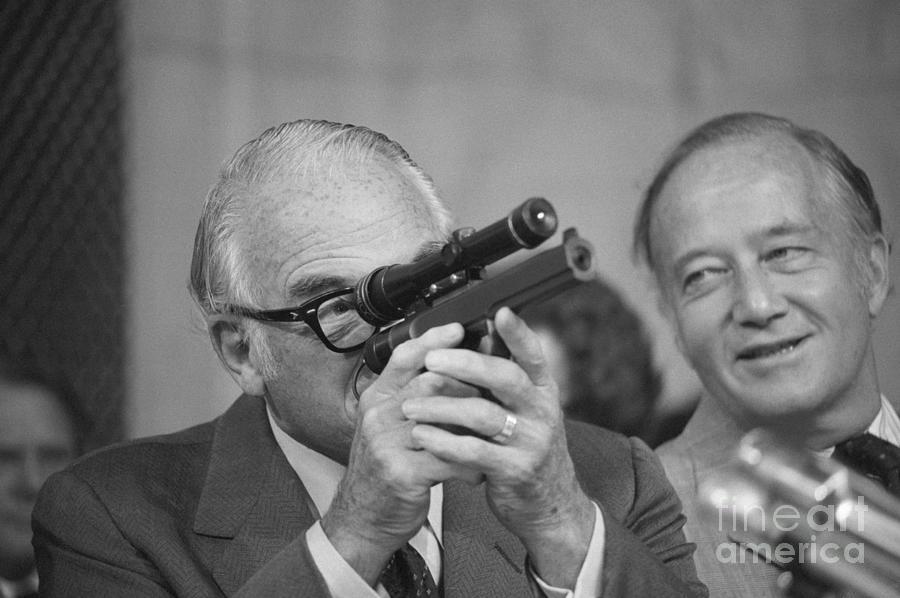 Barry Goldwater Sights Through Dart Gun Photograph by Bettmann