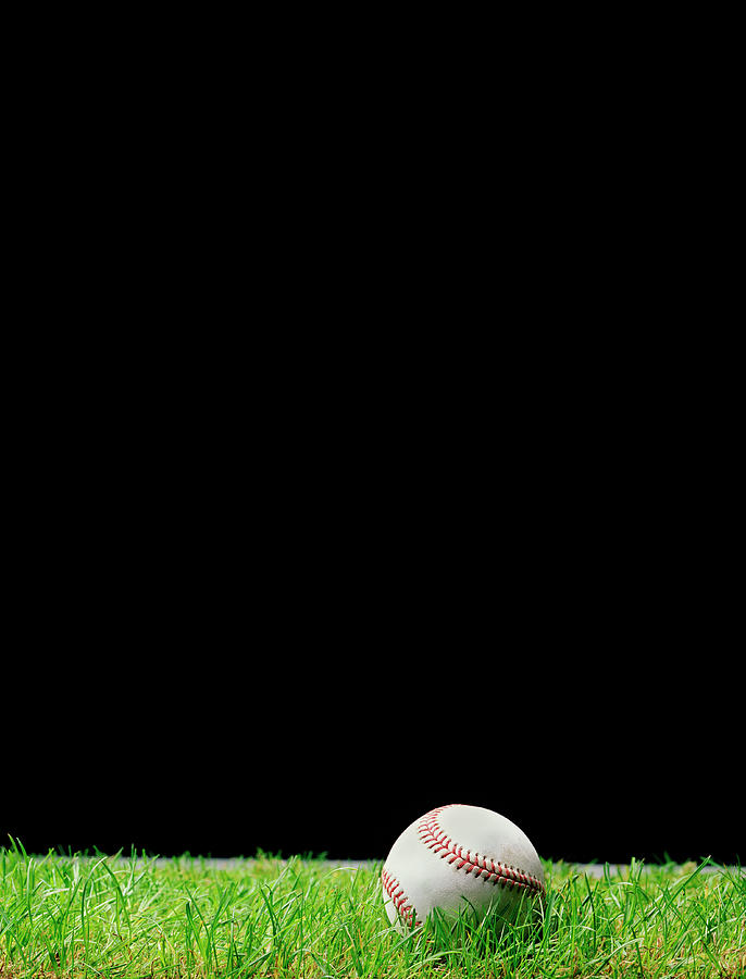 Baseball On Grass At Night Time Photograph by Peter Dazeley