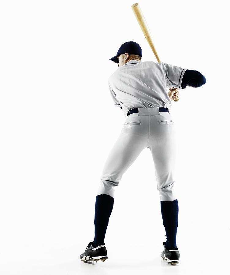 Baseball Player Swinging Bat From Behind Photograph by Patrik Giardino