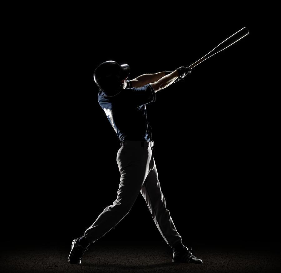 Baseball Player Swinging Bat Photograph by Lewis Mulatero