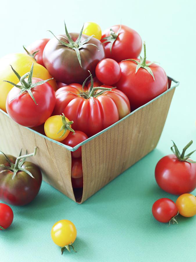 Basket Of Heirloom Tomatoes Photograph by Lauren Burke